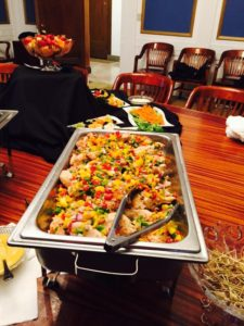 A tray of mango and pineapple salsa grilled chicken breast