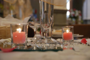 Pink candles in glass holders