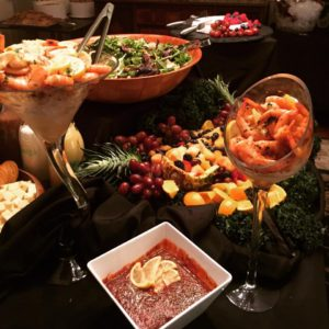 Bowls of shrimp dishes, salads, and fruits